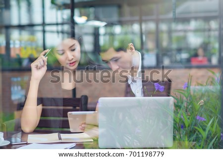 Business woman and business man is working in cafe   , buseness concept #701198779