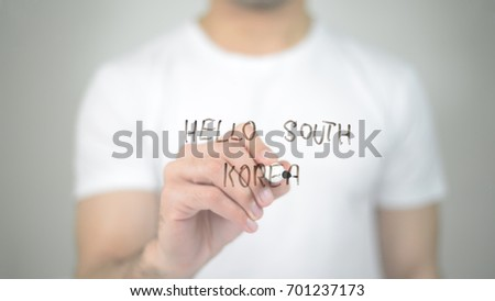 Hello South Korea, man writing on transparent screen #701237173