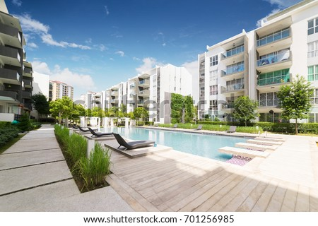 Modern residential buildings with outdoor facilities, Facade of new low-energy houses . Royalty-Free Stock Photo #701256985
