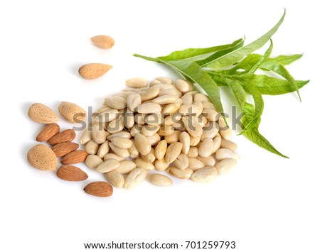 Blanched almonds  with unshelled nuts. On white background. #701259793