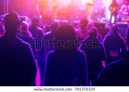 People at the concert in the pink light  #701376334