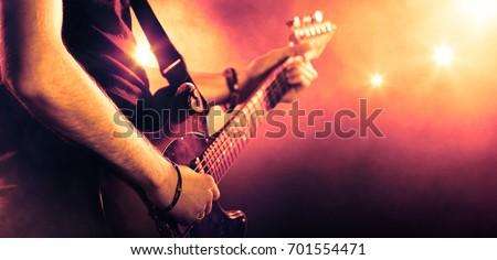 Musician holding a guitar