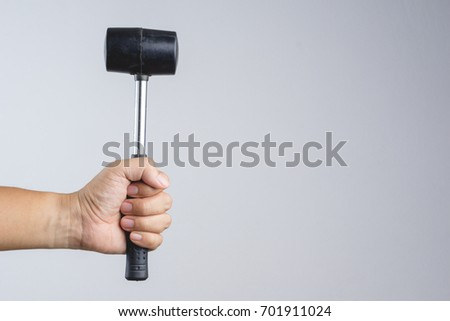 Rubber mallet or hammer with steel stick, mason tool for adjusting brick pavement or folding a metal sheet on white background #701911024