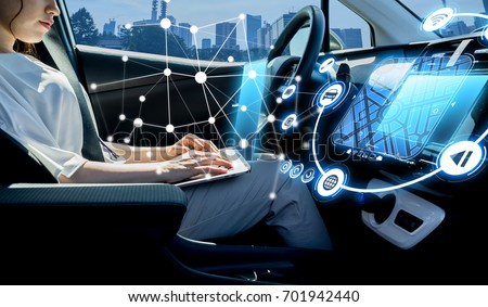 young woman riding autonomous car. self driving vehicle. #701942440