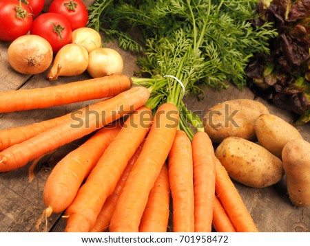 Healthy food concept with fresh vegetables on a rustic wooden kitchen table #701958472