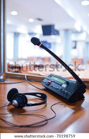 interpreting - Microphone and switchboard in an simultaneous interpreter booth (color toned image) Royalty-Free Stock Photo #70198759