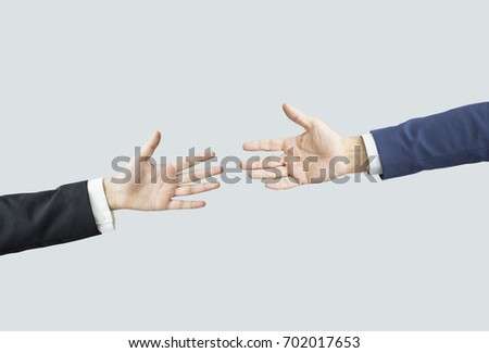 Hands reaching each other #702017653