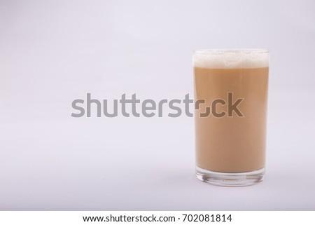 "Top view ""Teh Tarik""  or tea with milk is a popular drinks among Malaysian. #702081814"