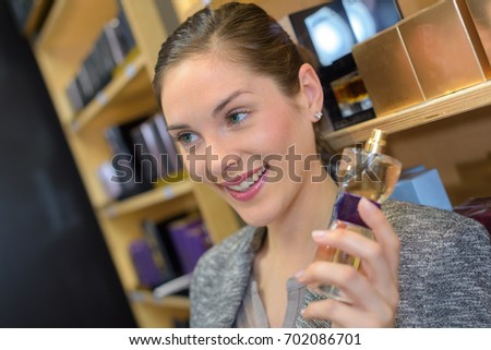 beautiful saleswoman showing beauty products to male customer #702086701