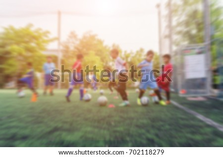 blurred background kid soccer player in academy. #702118279