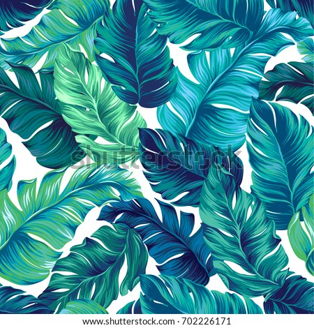 turquoise and green tropical leaves. Seamless graphic design with amazing palms. Fashion, interior, wrapping, packaging suitable. Realistic palm leaves. Royalty-Free Stock Photo #702226171