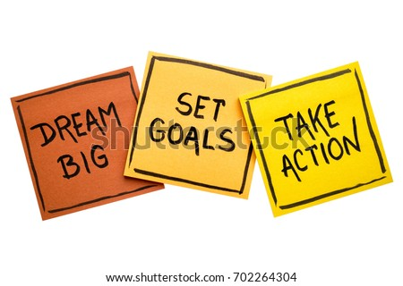 dream big, set goals, take action concept - motivational advice or reminder on colorful sticky notes isolated on white Royalty-Free Stock Photo #702264304