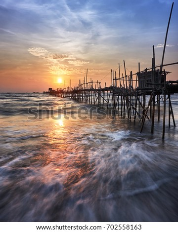 Sunrise in Tanjung Pasir beach #702558163