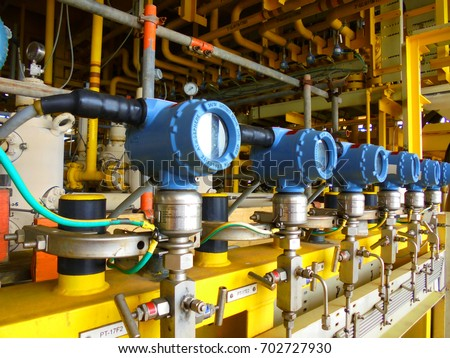 Pressure transmitter, and temperature transmitter for measurement and monitor data of oil and gas process.Install on oil and gas pipe line. Royalty-Free Stock Photo #702727930