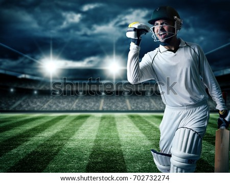 Cricket player batsman showing aggression after winning tournament #702732274