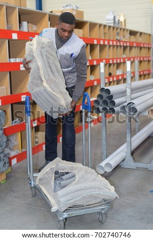man working in steelwork factory #702740746