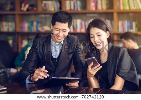 Business woman and business man is working in cafe   , buseness concept #702742120