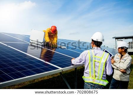 Technician team Repair and maintenance of solar panel #702808675