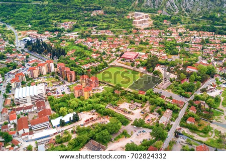 Top view of the beautiful city at the foot of the mountains #702824332