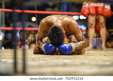 Fighter Muay Thai bowed in the ring Royalty-Free Stock Photo #702952216