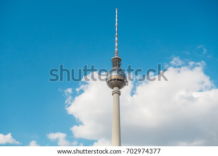 tv-tower with big fluffy clouds #702974377