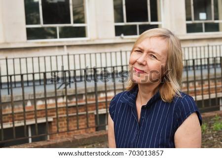 mature woman outside office #703013857