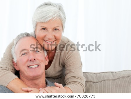 Lovers hugging while they are looking at the camera #70328773