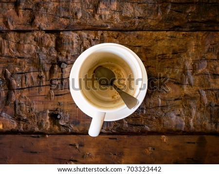 Empty coffee cup on wooden table. #703323442