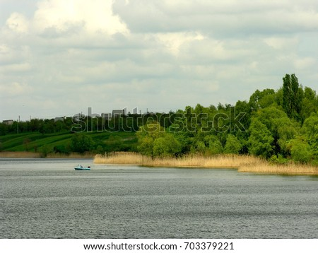 Lake view. Wild nature background. Spring season  #703379221