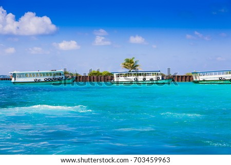 Tropical blue sea in island Male, country Maldives. Amazing nature landscape and boat. Wonderful luxury paradise. Beautiful exotic atoll.  Travel background.  Inspiration resort clear water.  #703459963