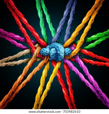 Holding together group as different ropes connected and tied and linked together in the center by a knot as a strong unbreakable chain and community trust and faith metaphor. Royalty-Free Stock Photo #703482610