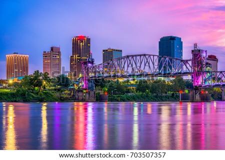 Little Rock, Arkansas, USA downtown skyline on the Arkansas River. Royalty-Free Stock Photo #703507357