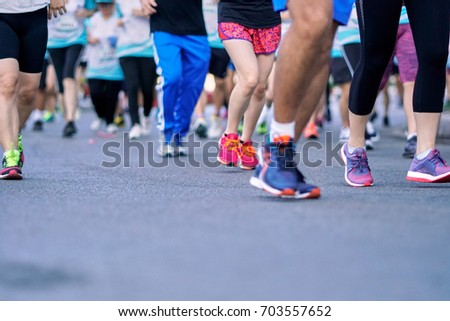 Group of people running race marathon. #703557652