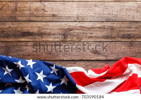 American flag on a old wooden Royalty-Free Stock Photo #703590184