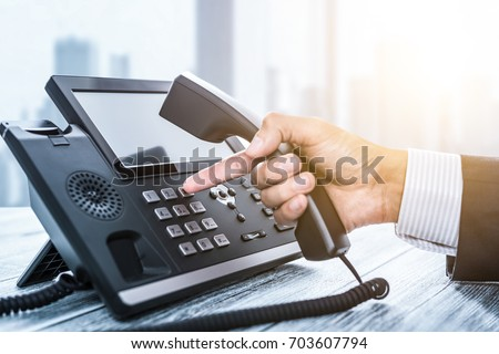 Communication support, call center and customer service help desk. Using a telephone keypad.  #703607794