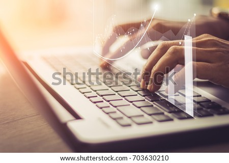 businessman hand working with new modern computer and business strategy as concept  / soft focus picture / Vintage concept