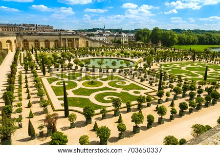 Versailles, France: Gardens of the Versailles Palace near Paris, France. Royalty-Free Stock Photo #703650337