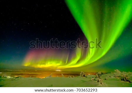 Aurora borealis (also known like northern or polar lights) beyond the Arctic Circle in winter Lapland. #703652293