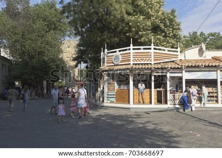 Evpatoria, Republic of Crimea, Russia - July 19, 2017: Walk along the shady Karaite street, one of the streets of Lesser Jerusalem, Evpatoria #703668697