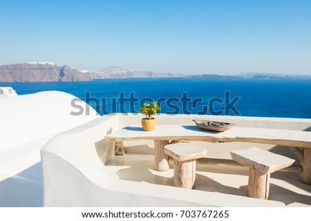 White architecture on Santorini island, Greece. Summer landscape, sea view. #703767265