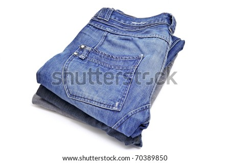 a pile of blue jeans on a white background #70389850