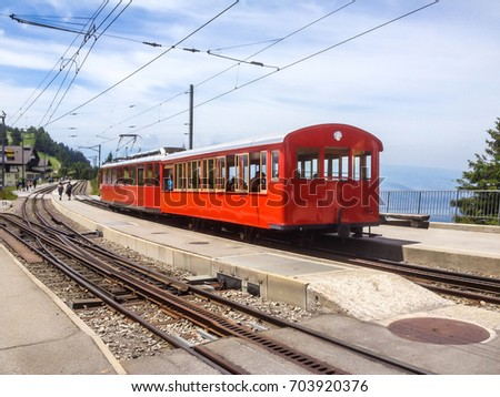 the standard gauge railway from Vitznau to Rigi Kulm is highest in Europe. Travel thru beautiful Swiss alpine scenery toward top of majestic mountain peaks by public mass railway transportation system #703920376