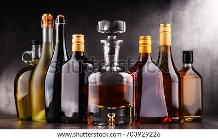 Composition with bottles of assorted alcoholic beverages. #703929226