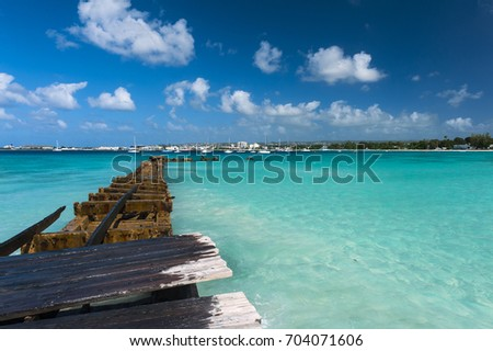 Old broken pier near Bridgetown, Barbados #704071606