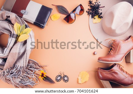 Autumn female outfit. Set of clothes, shoes and accessories on brown background #704101624