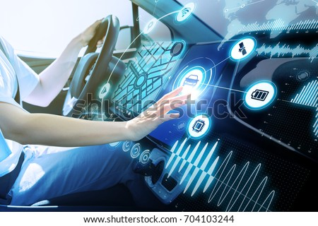 futuristic vehicle and graphical user interface(GUI). intelligent car. connected car. Internet of Things. Heads up display(HUD). #704103244