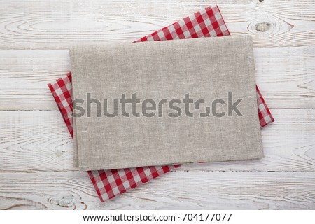 Napkin on table in perspective. Napkin close up top view mock up for design. Place for text #704177077