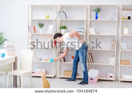 Man doing cleaning at home #704184874