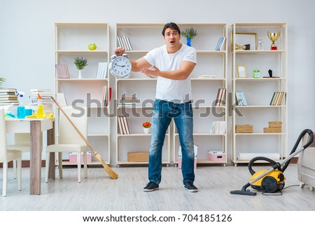Man doing cleaning at home #704185126