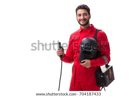 Young repairman with a welding gun electrode and a helmet isolat #704187433